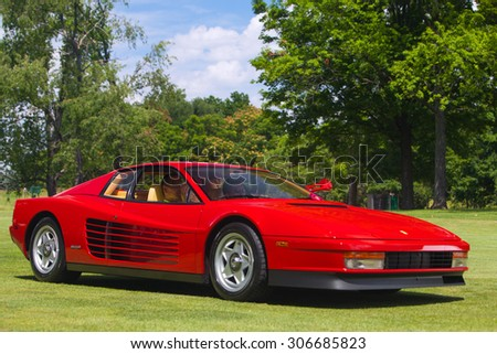 PLYMOUTH - JULY 26: A Ferrari Testarossa on display July 26, 2015 at the Councors D'Elegance in Plymouth, Michigan.