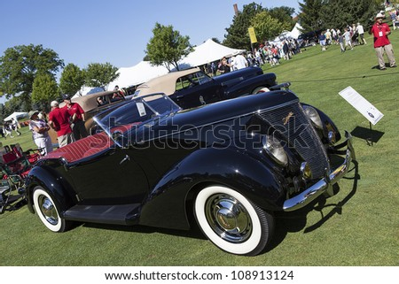 PLYMOUTH - JULY 29 : A 1937 Ford convertible on display at the Concours D'Elegance  July 29, 2012 in Plymouth, Michigan.