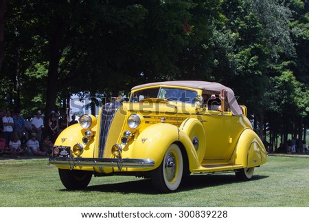 PLYMOUTH - JULY 26: A 1936 Hudson convertible coupe on display July 26, 2015 at the Councors D'Elegance in Plymouth, Michigan. - stock photo