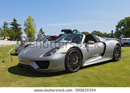 PLYMOUTH - JULY 26: A Porsche 918 Spyder on display July 26, 2015 at the Councors D'Elegance in Plymouth, Michigan.