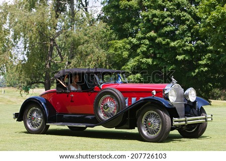 PLYMOUTH - JULY 27: A vintage roadster on display July 27, 2014 at the Concours D' Elegance Plymouth, Michigan.