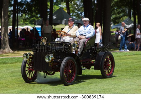 PLYMOUTH - JULY 26: A 1905 vintage steam engine car on display July 26, 2015 at the Councors D'Elegance in Plymouth, Michigan. - stock photo