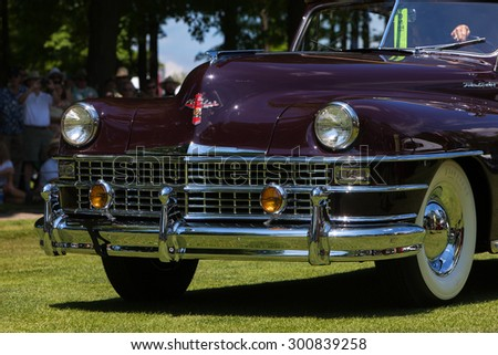 PLYMOUTH - JULY 26: Close-up grill of a vintage Chrysler Town & Country  July 26, 2015 at the Councors D'Elegance in Plymouth, Michigan. - stock photo