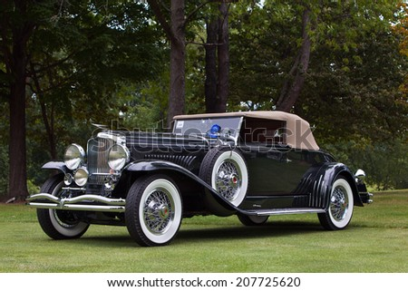 PLYMOUTH - JULY 27: The best in show American winner 1932 Duesenberg J154 on display July 27, 2014 at the Concours D' Elegance Plymouth, Michigan. - stock photo