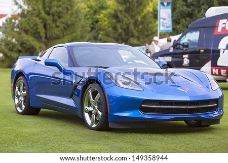 PLYMOUTH - JULY 28 : The new 2014 Corvette Stingray at the Concours D'Elegance  July 28, 2013 in Plymouth, Michigan. - stock photo