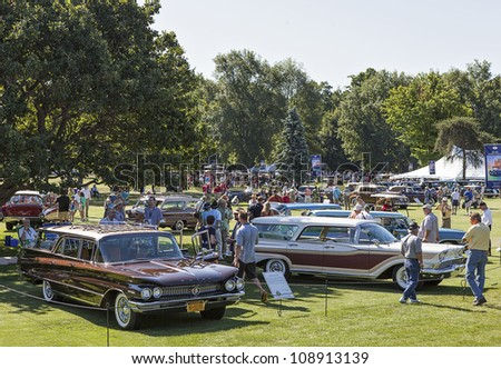 PLYMOUTH - JULY 29 : Visitors enjoy the show at the Concours D'Elegance  July 29, 2012 in Plymouth, Michigan.