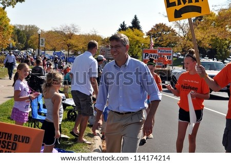 PLYMOUTH, MN. - SEPT. 29: US Congressman Erik Paulsen marches in the Plymouth Parade on September 29, 2012, in Plymouth, Minnesota. - stock photo