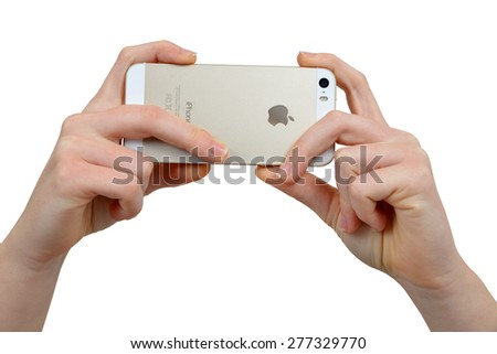 Plzen,Czech Republic - December 5, 2014 : Woman Hand Holding Apple iPhone 5S Smart Phone - stock photo