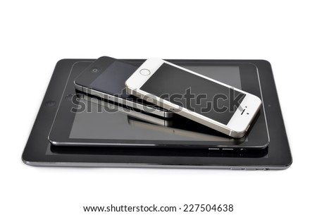 Plzen,Czech Republic - October 11, 2014 : iPad air ,iPad mini ,iPhone 4S and iPhone 5S Smart Phone developed by Apple Inc. - stock photo