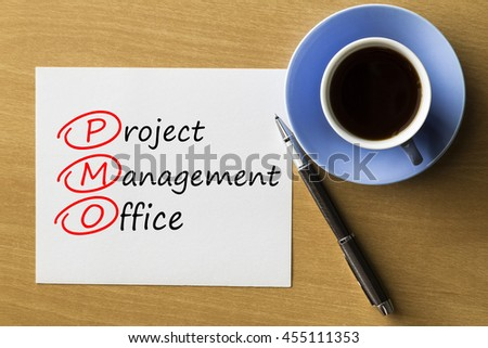 PMO Project Management Office - handwriting on paper with cup of coffee and pen, acronym business concept
