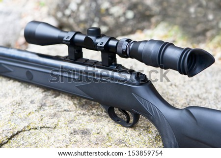Pneumatic air rifle with optical sight