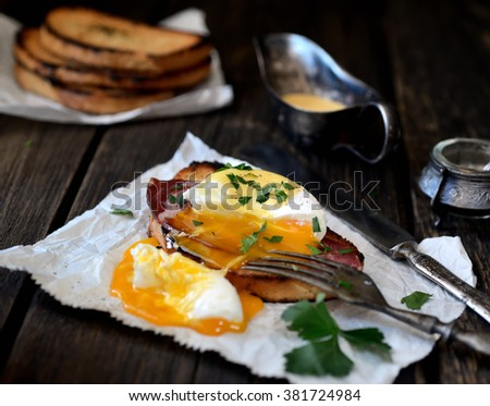 Poached egg with bacon and toaster on paper - stock photo
