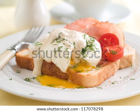 Poached egg with bacon on bread, selective focus - stock photo