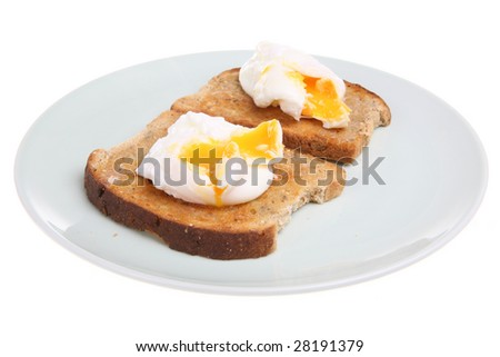 Poached eggs on wholemeal buttered toast - stock photo