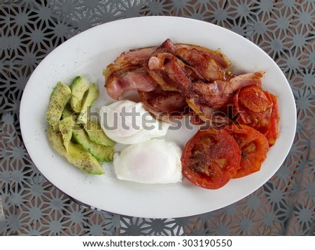 Poached Eggs with Bacon 2 - stock photo