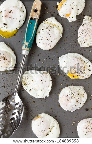 Poached eggs with cracked black pepper - stock photo