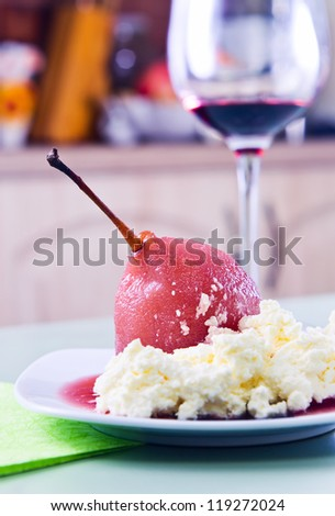 Poached pear and mascarpone with red wine sauce - stock photo