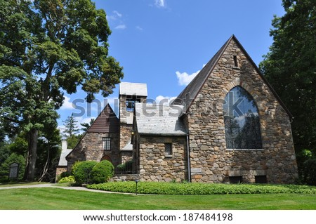 POCANTICO HILLS, NY - AUG 16: Union Church of Pocantico Hills in New York State, on Aug 16, 2013. It was built by John D. Rockefeller, Jr. and is listed in the National Register of Historic Places. - stock photo