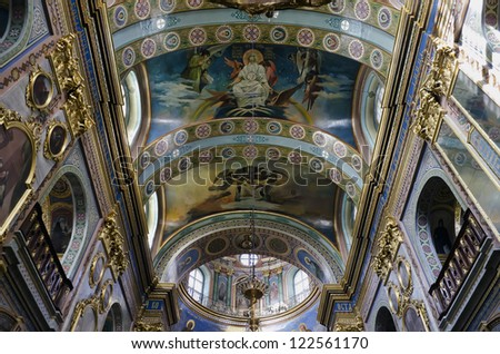 POCHAEV, UKRAINE - OCT 05: Very well preserved frescoes on dome and vaults of religious themes in Holy Dormition Cathedral in Pochayiv Lavra on October 05, 2012 in Pochaev, Ukraine.