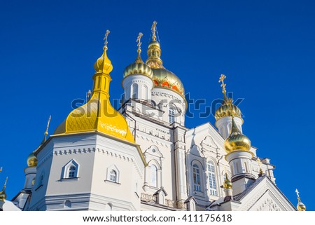 Pochayiv Lavra - church golden domes against the clear blue sky. Ukraine - stock photo