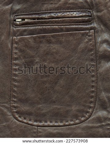 Pocket as a fragment of brown leather jacket.