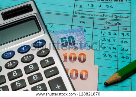pocket calculator, money and sales slips