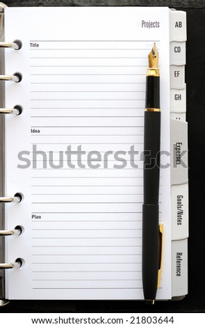 Pocket planner with pen close up