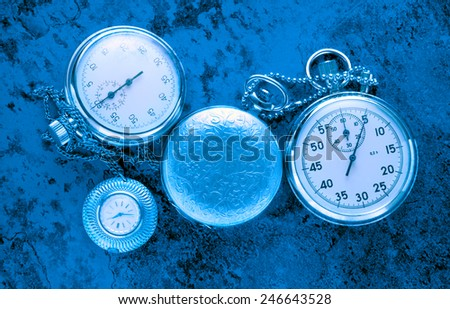 Pocket vintage watch and stopwatch in toning - stock photo