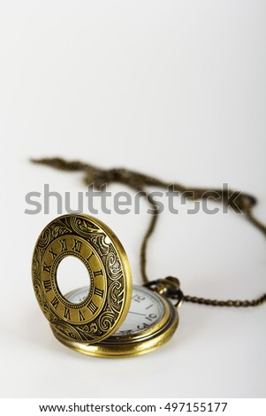 Pocket watch against a light coloured background