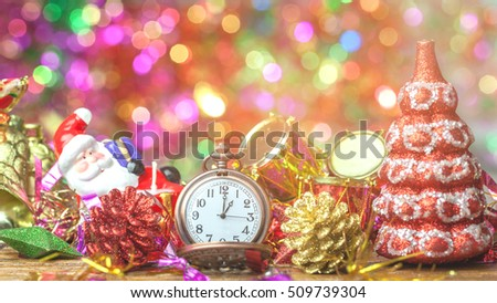 pocket watch and christmas with decorations on wooden background