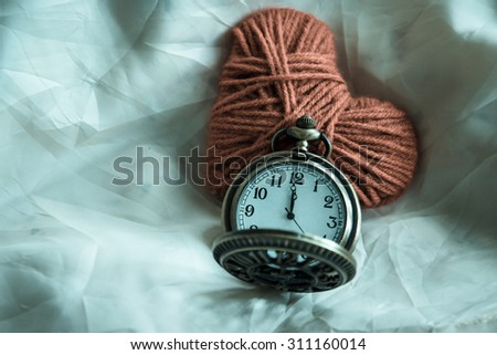 Pocket watch and love heart on fabric,still life ,love concept,vintage - stock photo