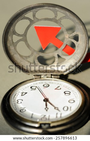 Pocket watch and red arrow