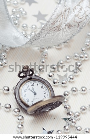 Pocket watch in a box on a festive background
