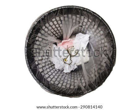 Pocket watch in refuse bin isolated on white background. Top view. Concept of wasting time - stock photo