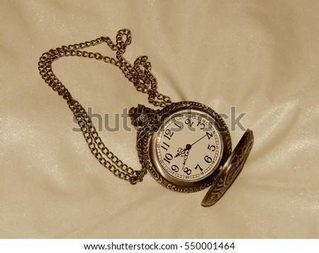 Pocket watch in the style of a retro image