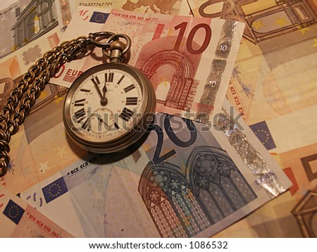 Pocket watch on a variety of EU currency
