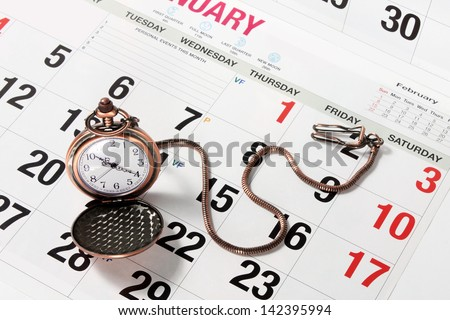 Pocket Watch on Calendar