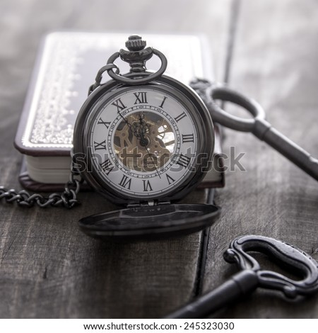 pocket watch on grunge wooden table, close up - stock photo