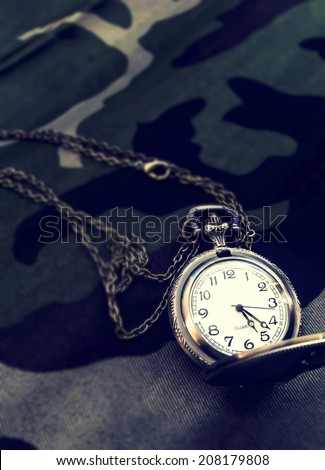 Pocket watch on Military fabric pattern vintage style - stock photo