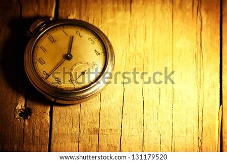 pocket watch on wood background - stock photo