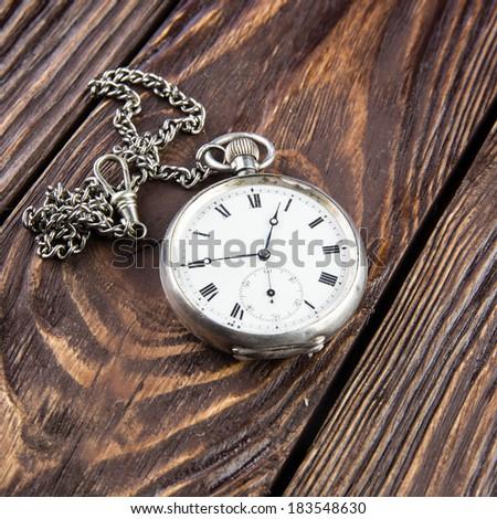 Pocket watch on wood background - stock photo