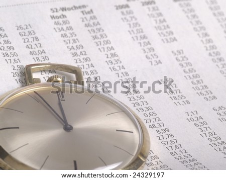 pocket watch over stock chart numbers