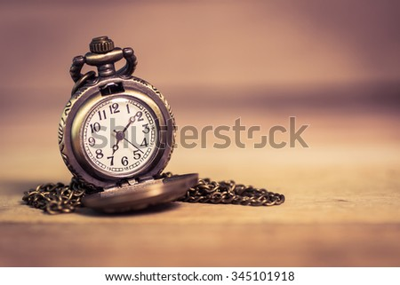 """pocket watch ,selective focus . Focus area are the dial of the clock,picture style """"old image"""" - stock photo"""