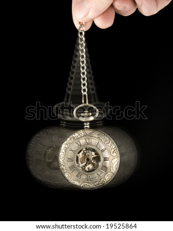 pocket watch swung as if to hypnotize - stock photo