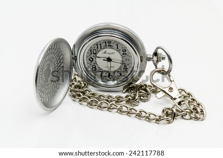 Pocket watch with chain fastened. On a white background. - stock photo