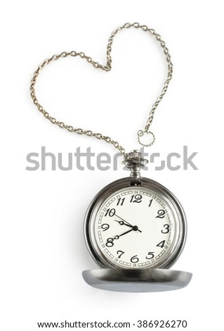 Pocket watch with chain in the form of heart isolated on white