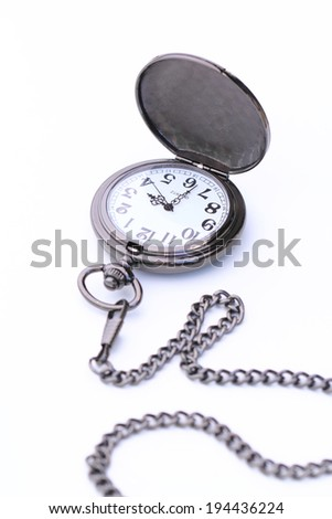 Pocket watch with its chain isolated on white background - stock photo