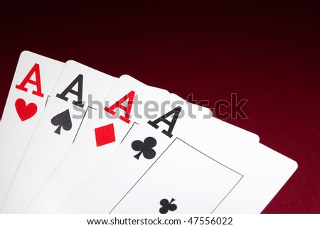 Pockets Aces with plenty of red background for textcopy