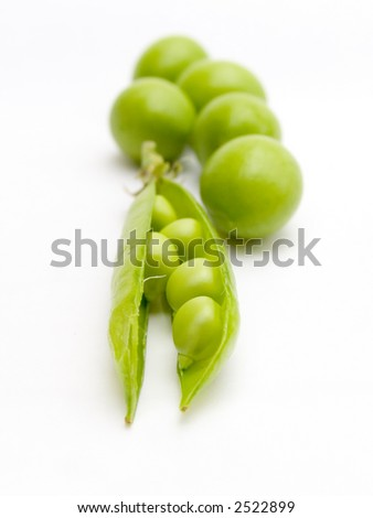 Pod of a green peas and fruits plums. Sharpness in the foreground. The isolated image on a white background