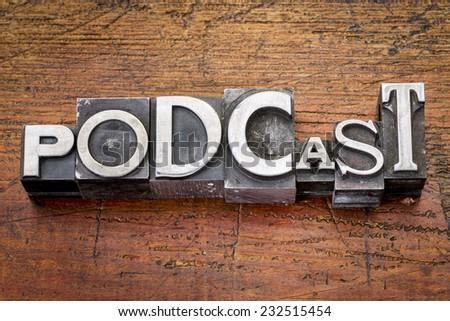 podcast word in vintage metal type printing blocks over grunge wood - stock photo